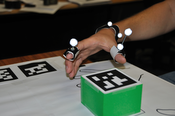 image1: Shows the green box and the markers for hand tracking